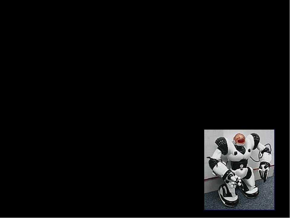 Робот, например, может ходить, грозить пальцем, кувыркаться, даже петь, и, и...