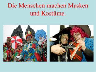 Die Menschen machen Masken und Kostüme.