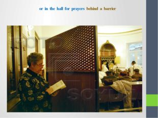 or in the hall for prayers behind a barrier