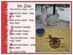 Im Zoo Das ist ein Löwe – rrrr! Das ist ein Hund – wau, wau, wau! Das ist ein