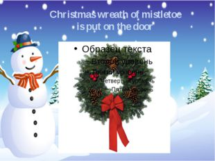 Christmas wreath of mistletoe is put on the door